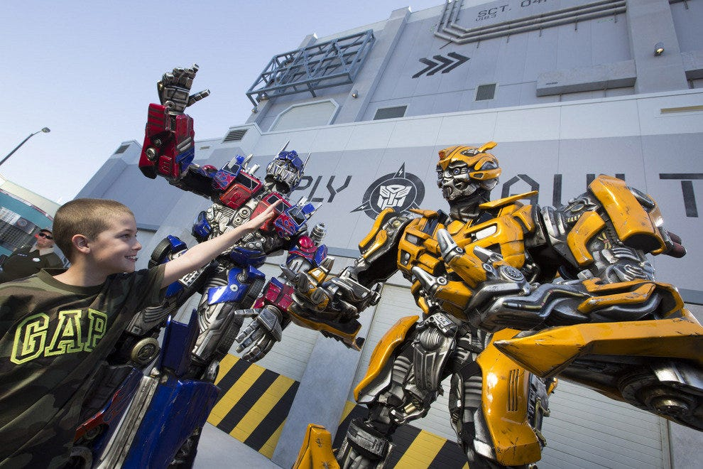 Heroes High-Five: Guests greet the Autobots at Universal Orlando Resort's newest attraction