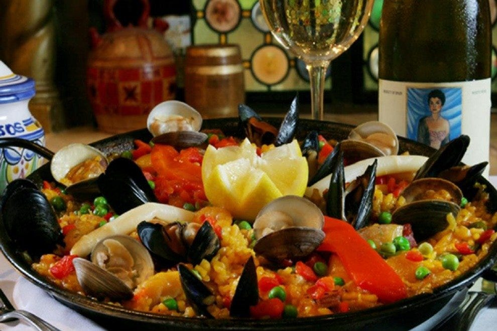 Tampa cuisine takes advantage of abundant local seafood, fresh produce and cultural influences. Pictured here is seafood paella served at Columbia Restaurant