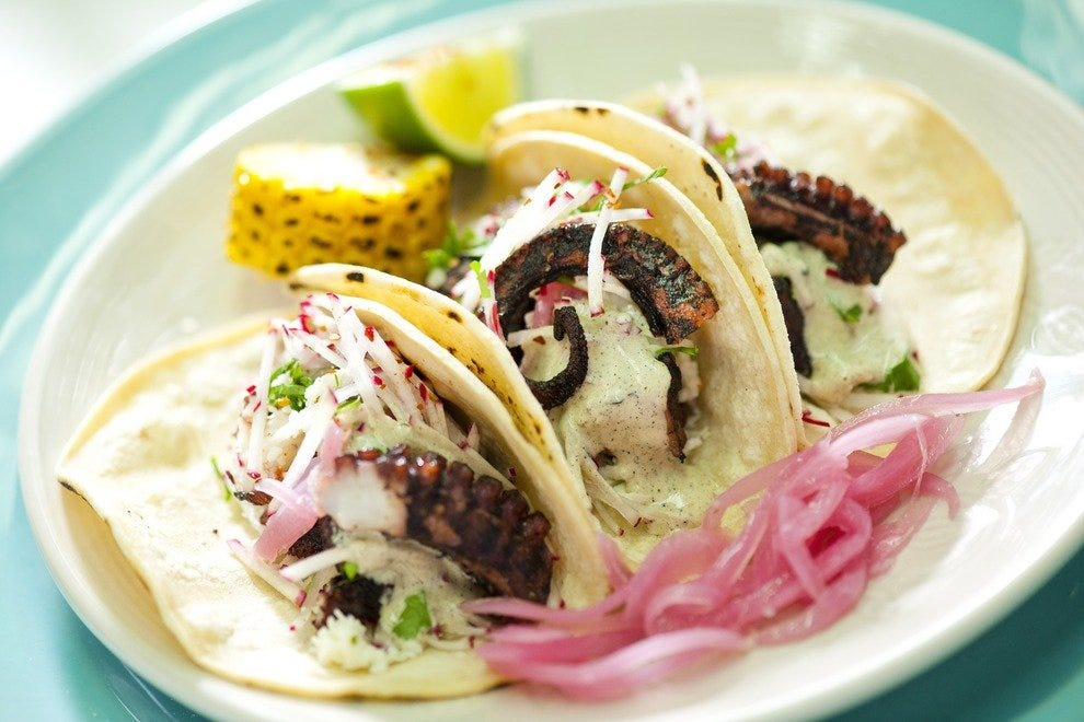 Picnickers bring any number of delicacies, including these grilled octopus tacos from nearby My Ceviche, to entertai their palates while listening to the New World Symphony.
