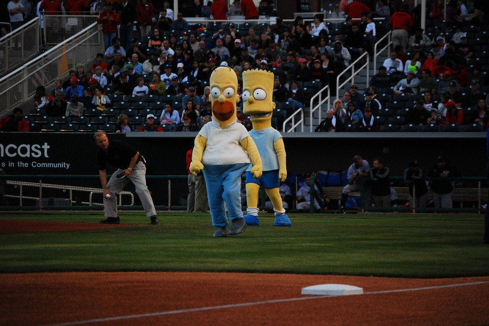 Homer and Bart take the field in Isotope Park