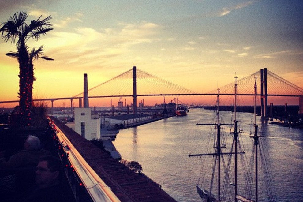 A view of the sun setting over the Talmadge Bridge from the rooftop patio at Rocks on the Roof.