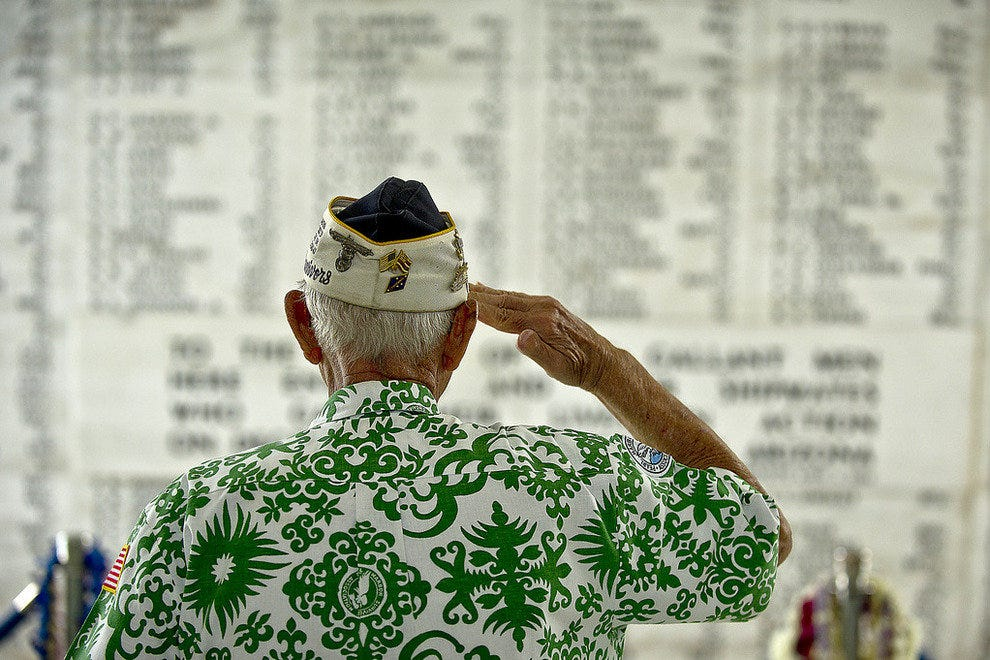 A survivor salutes at the USS Arizona Memorial
