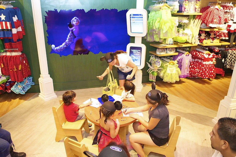 The newly designed Disney Store features several immersive experiences, like a Disney Theater that hosts special events and plays the latest in Disney entertainment
