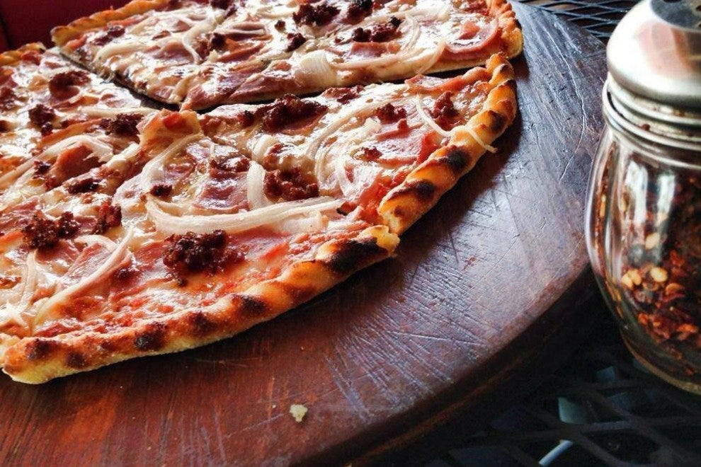 Padrino's pizza is baked in a coal-fired oven