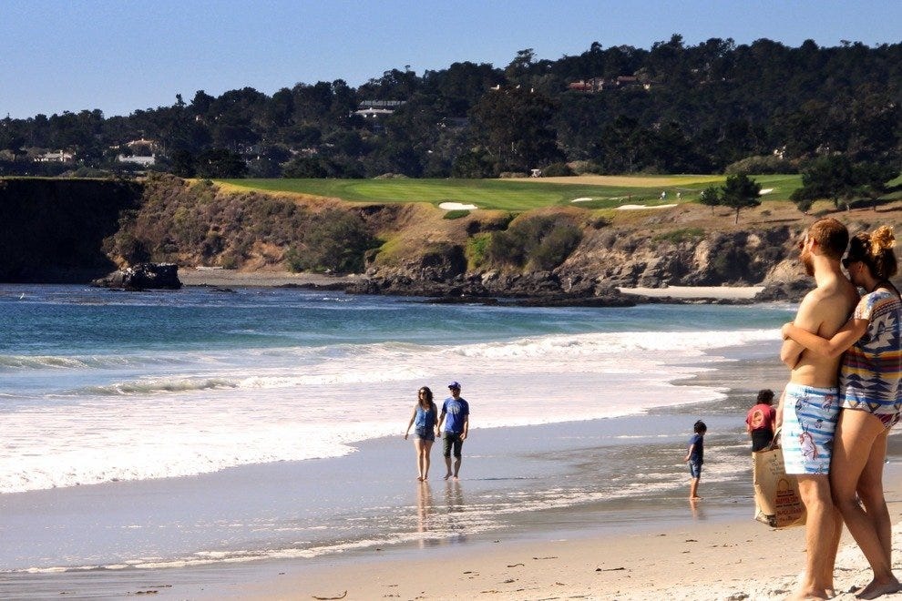 View on the beach at Carmel-by-the-Sea with the Pebble Beach Golf Course in the background