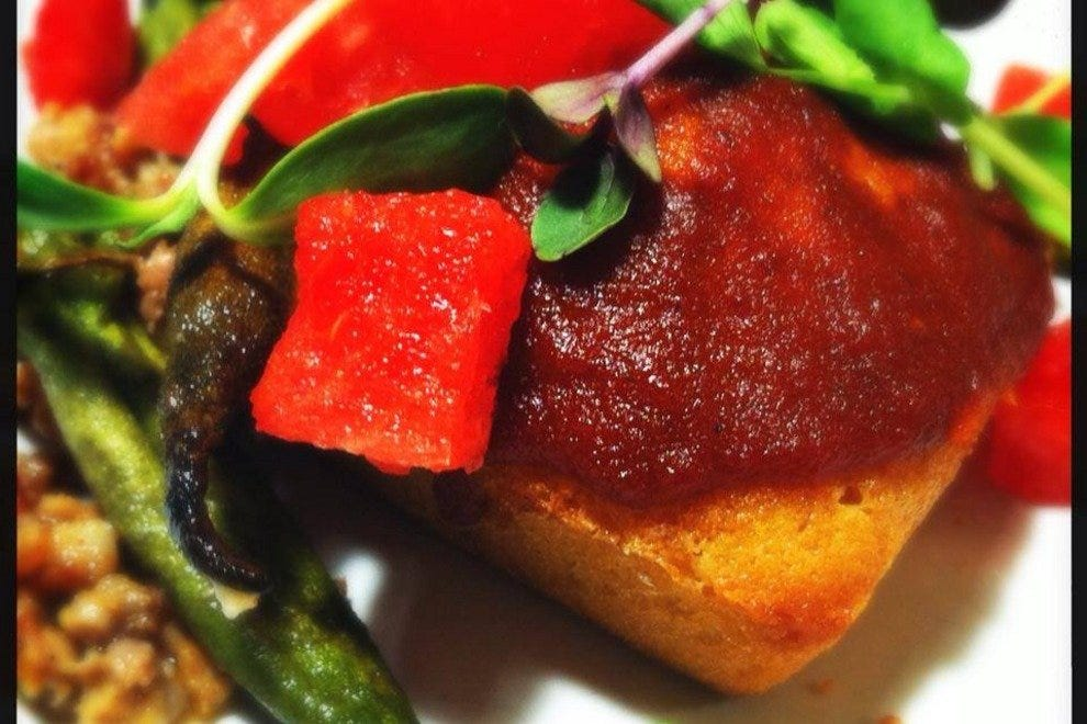 Pound cake with aji amarillo glaze, roasted okra, chorizo, watermelon and orange vinegar