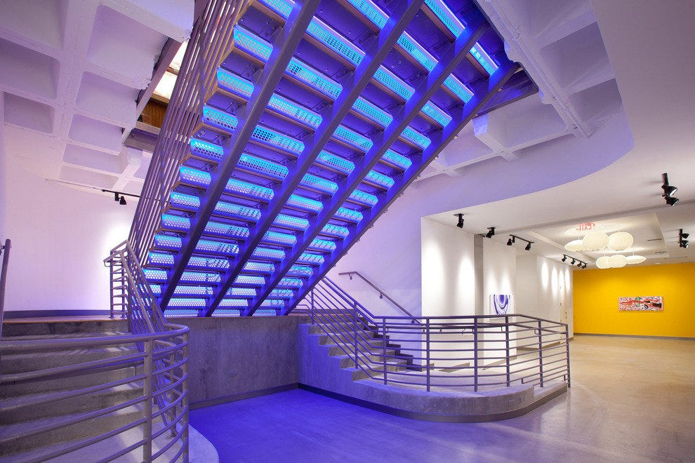Much like the color wash on the building's exterior, the Aloft staircase enjoys its own illumination