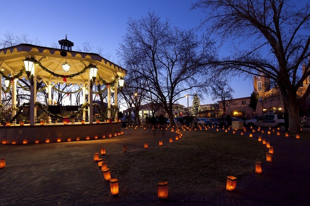 Albuquerque's Old Town Plaza on Christmas Eve is aglow in luminarias, paper sacks with candles.