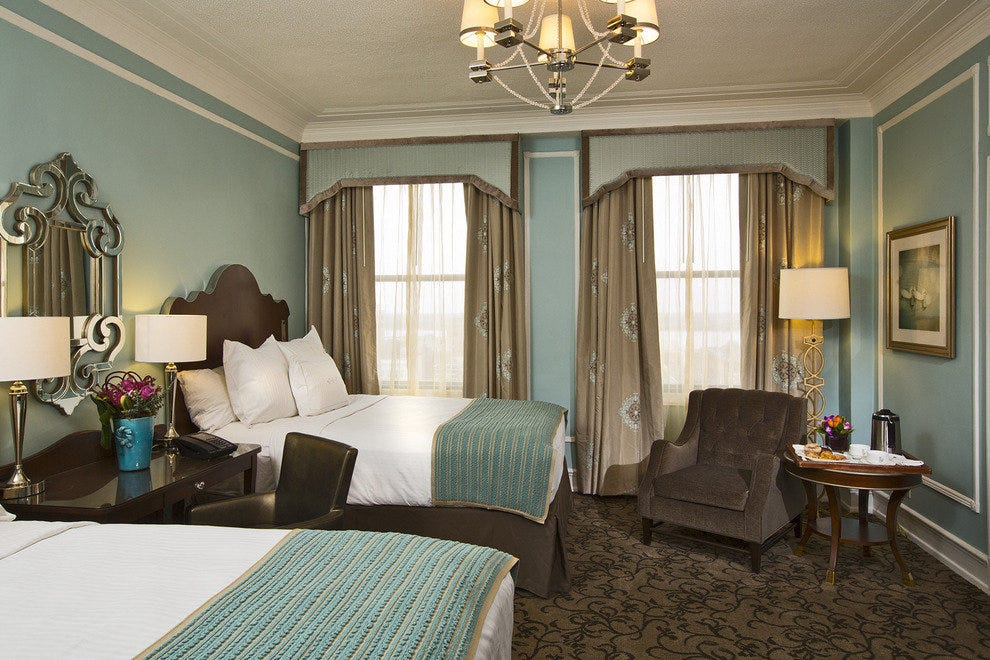 The refreshed rooms at the historic Peabody feature soft colors