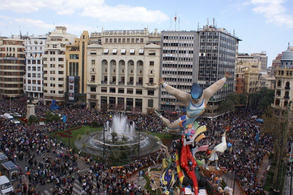 Reaching five stories high, the fallas, located on the Plaza del Ayuntamiento,  as seen  from the roof of Valencia's city hall. The fallas in this location is always the last of the 750 sculptures to burn during la crema March 19.