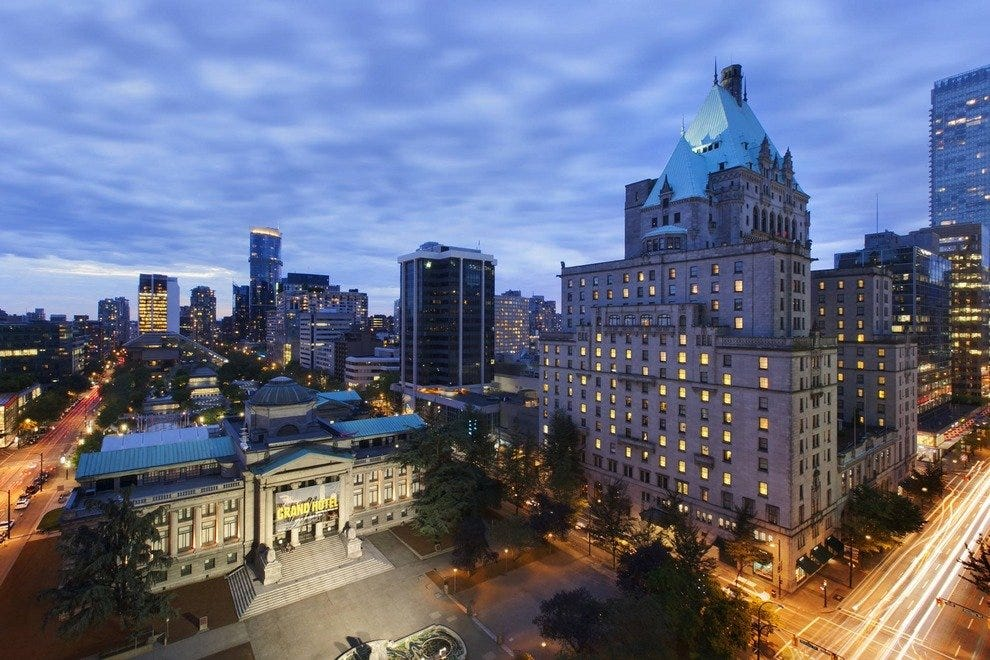 The Fairmont Hotel Vancouver lights up the evening sky