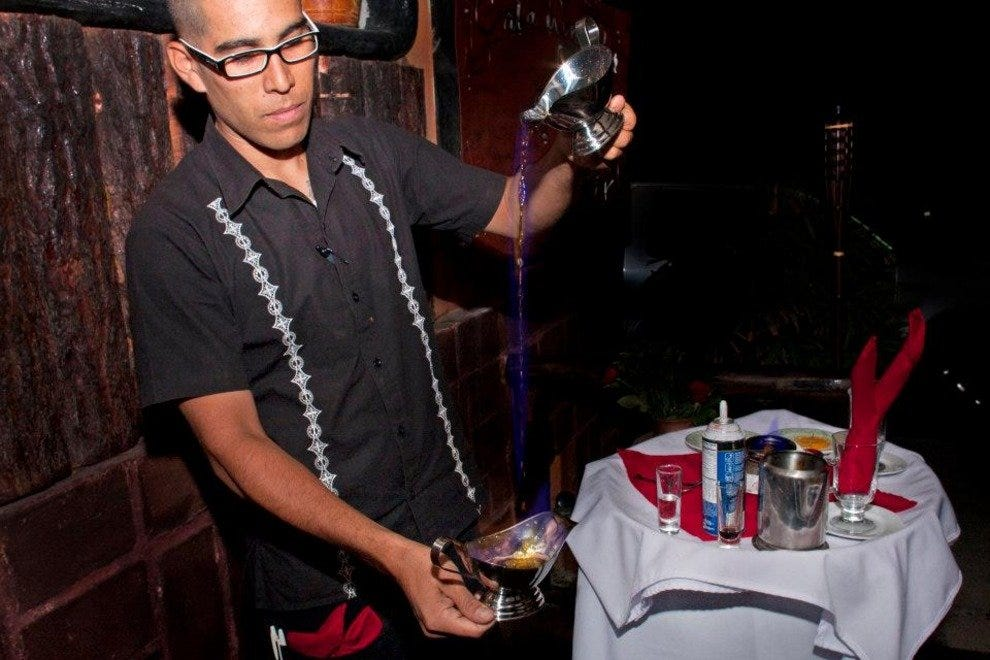 Flaming coffee service is one of the most memorable features at Cata Wine in San Jose del Cabo