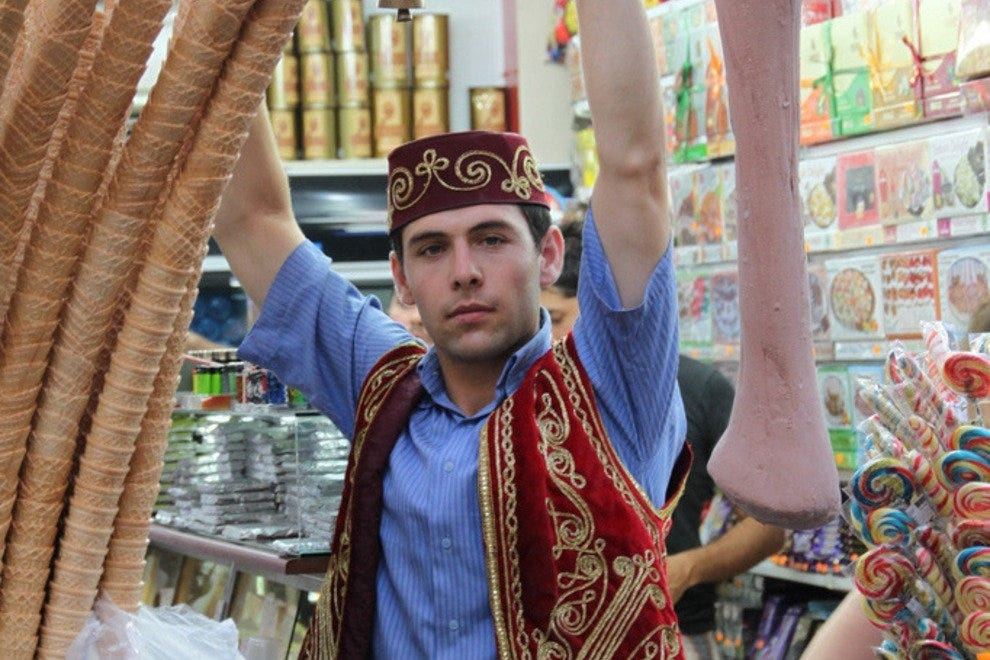 A Turkish ice cream vendor performs tricks with the gooey confection.