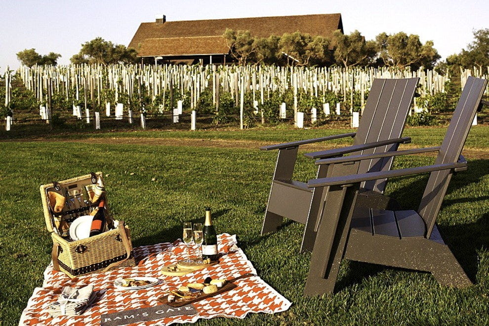 Picnic baskets herald the arrival of outdoor wine tasting.