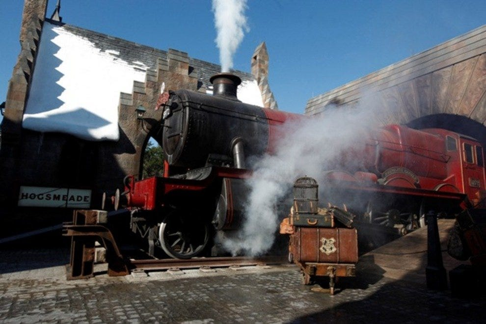 Guests entering Hogsmeade will be greeted by the smoke-billowing steam engine of the Hogwarts Express.