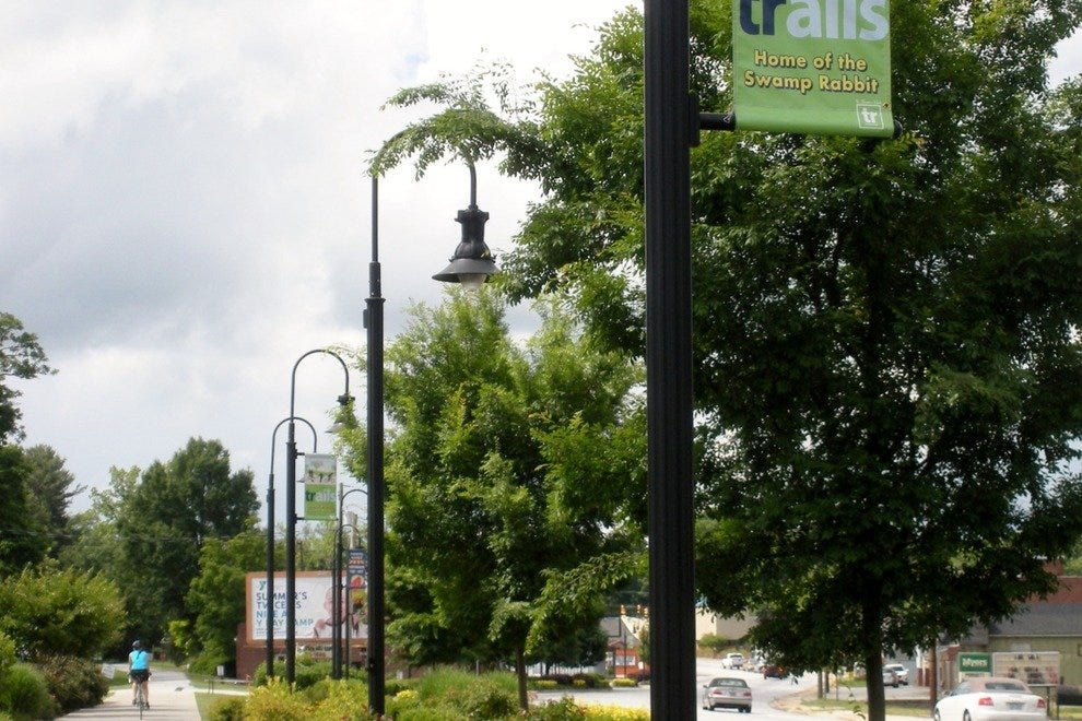 Outdoor adventurers enjoy the Swamp Rabbit Trail, which eventually runs parallel with Main Street in Travelers Rest