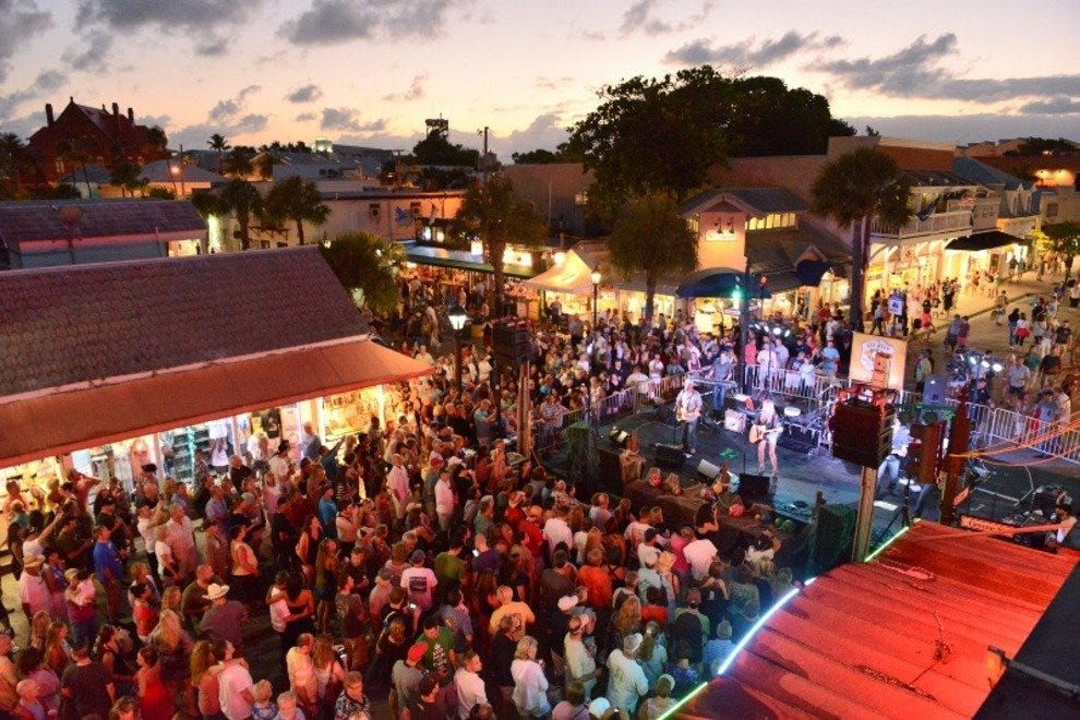Crowds gather on Duval Street for the main stage shows during the 18th Annual Key West Songwriter's Festival.