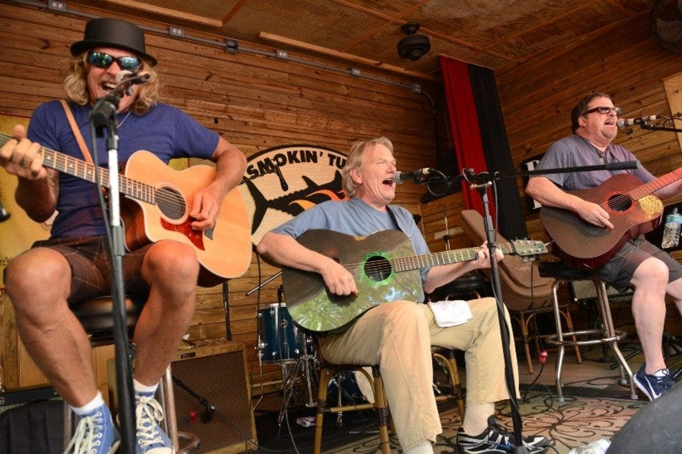 Jeffrey Steele, Big Al Anderson and Bob DiPiero perform at Smokin' Tuna during the 18th Annual Key West Songwriter's Festival.