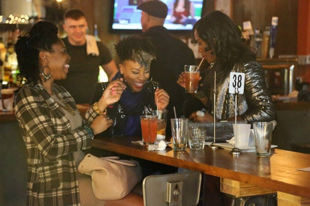 Enjoy drinks with friends during a RAW event at Penn Social.