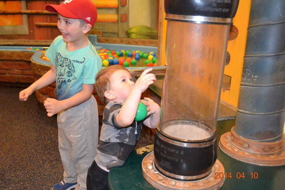 Two boys play at the Museum of Science and Industry's Idea Factory exhibit.
