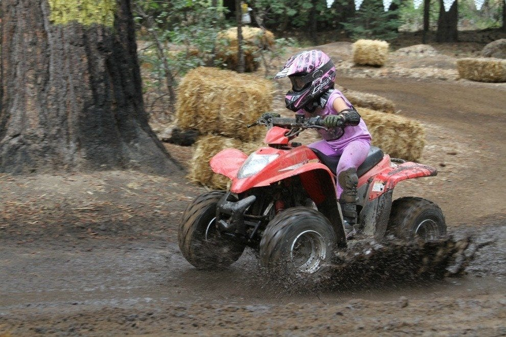 A girl taking an ATV ride