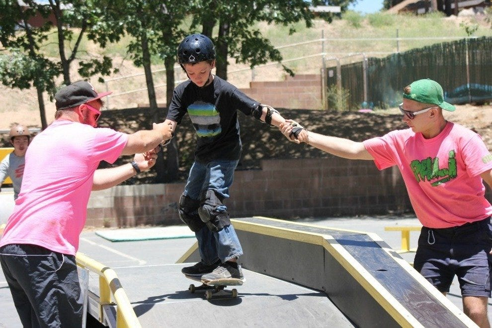 Learning to skateboard with camp counselors
