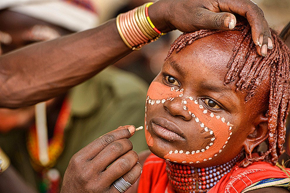 Hamer young woman getting her face painted