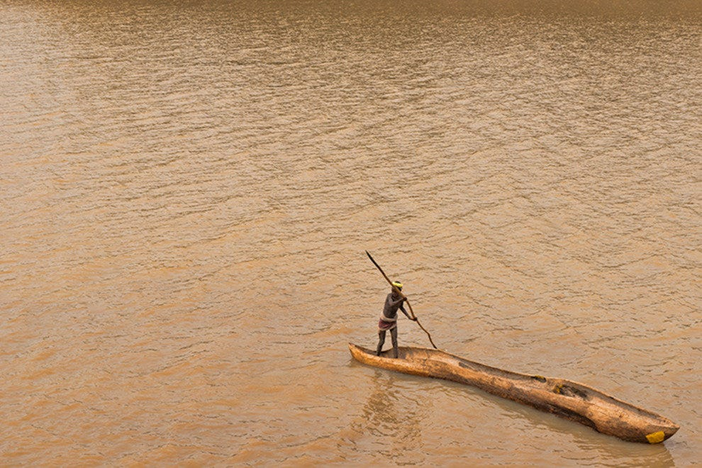 Dassanech crossing the Omo River with dugout canoe