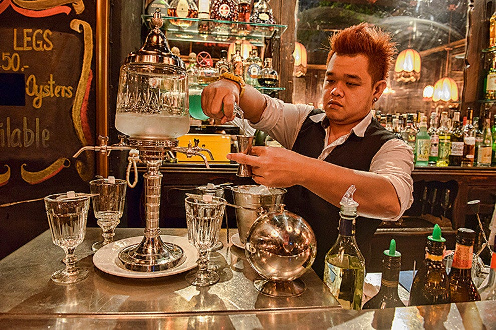 Bartender pours absinthe at Le Derriere
