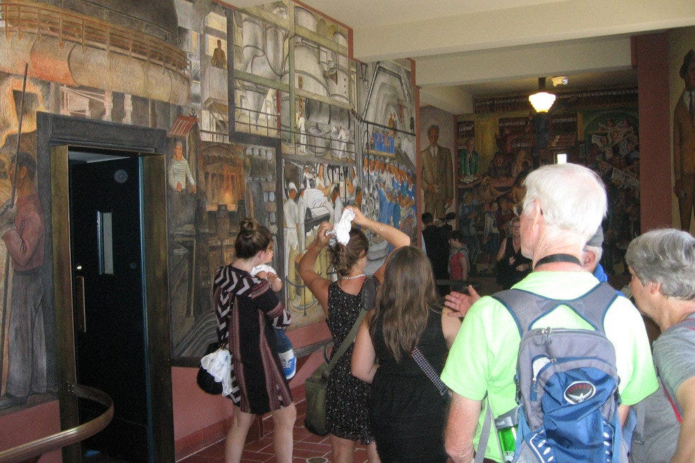 Visitors enjoy the refurbished murals after the re-opening ceremony.
