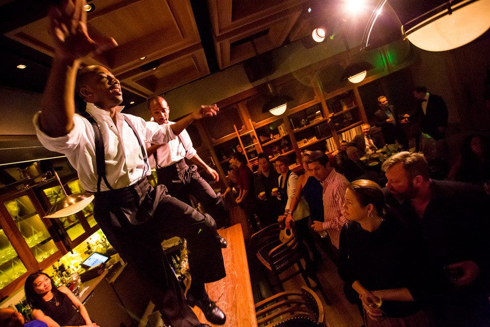 "Cast members from ""Vegas Nocturne"" tap dance on the bar inside the study at Rose.Rabbit.Lie."