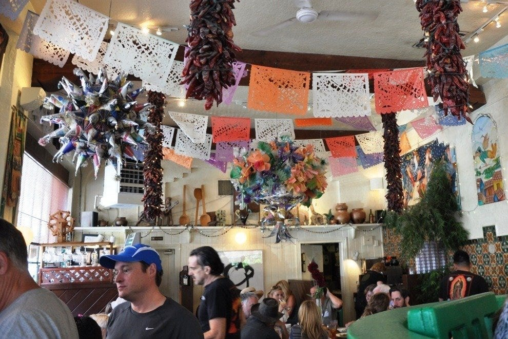 The festive dining room decor at Cafe Pasqual's evokes Mexico