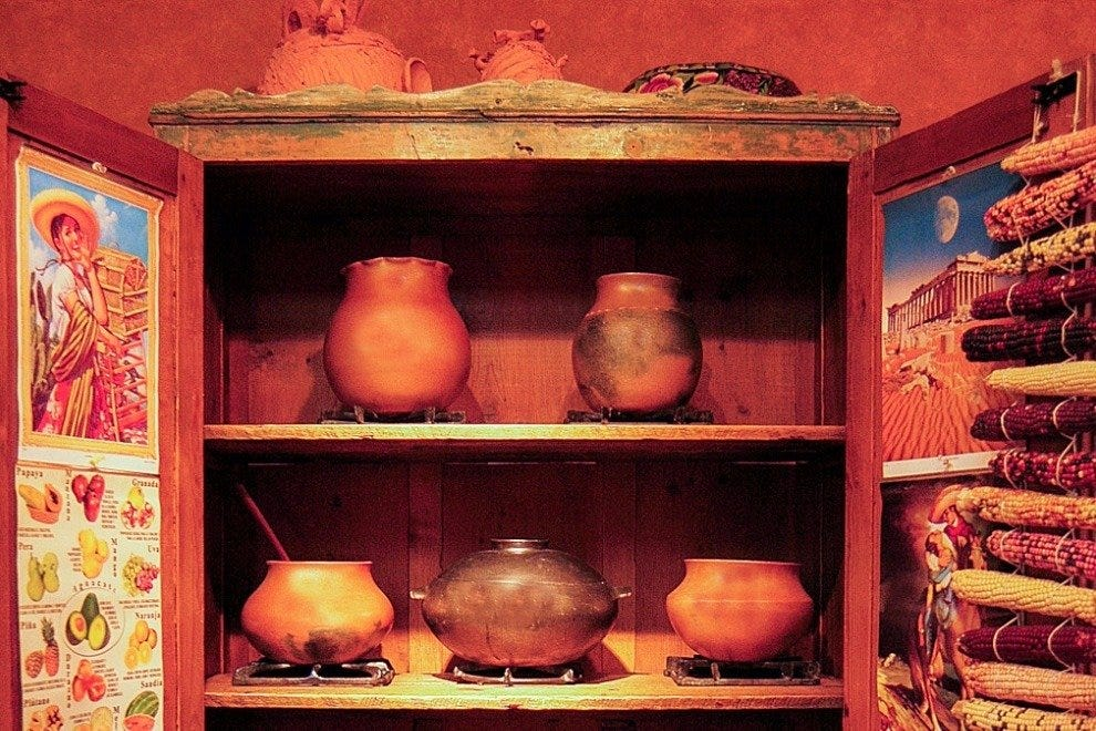 Micaceous clay cookware made by Jicarilla Apache potter Felipe Ortega is in Pasqual's gallery