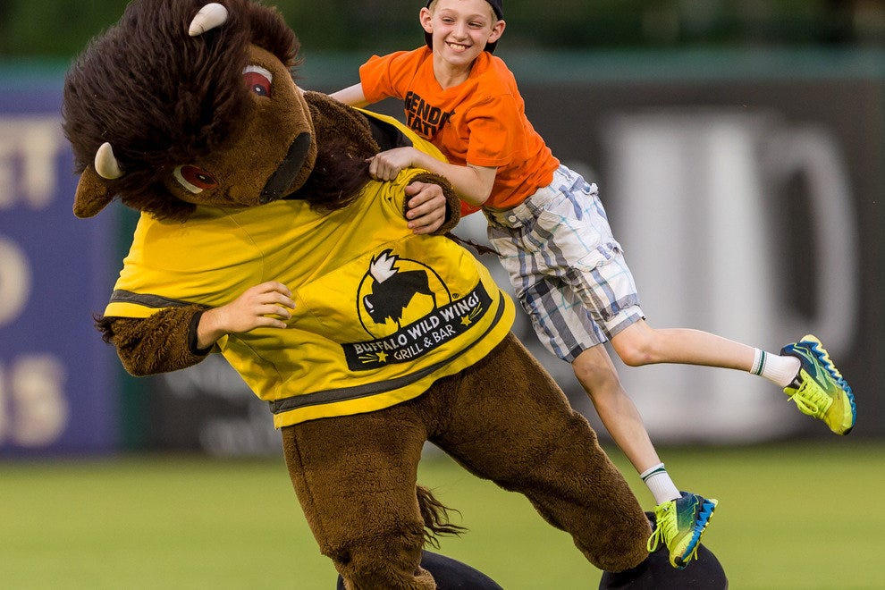Miracle fans can't wait for the chance to tackle the mascot for Buffalo Wild Wings restaurant between innings