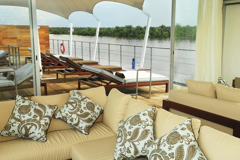 Viewing the Amazon from the deck of the MV Aqua keeps the mojito within reach and the pirahna a nice distance away