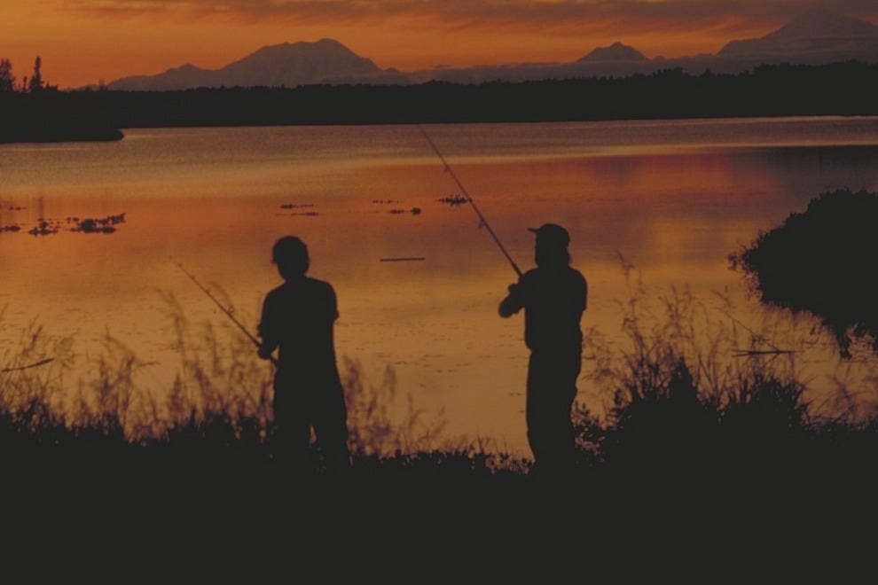 The sun sets late during Alaska's summer, allowing the rod and reel set more time to fish.