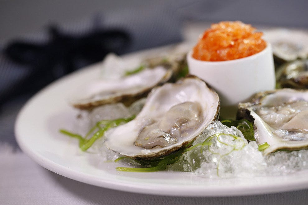 Raw oysters presented with a boldly hued granita