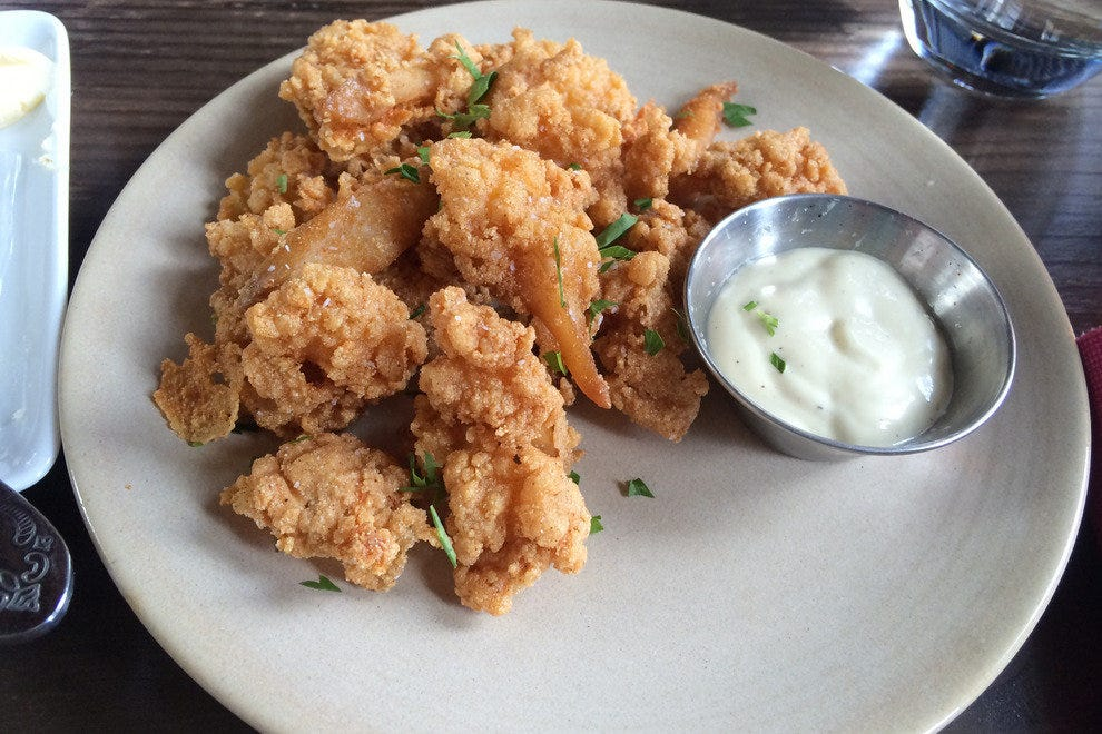 Fried surf clams accompanied by aioli. Add sugar snap slaw and a Colorado craft beer for meal perfection