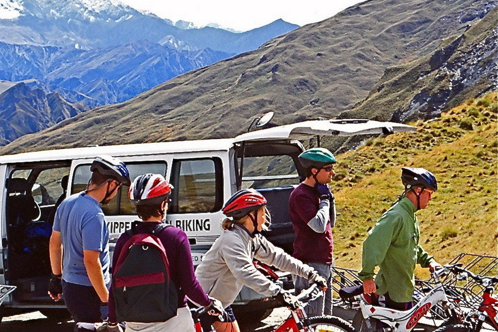 Mountain bikers get ready to ride Skippers Canyon, a popular mountain biking track near Queenstown.