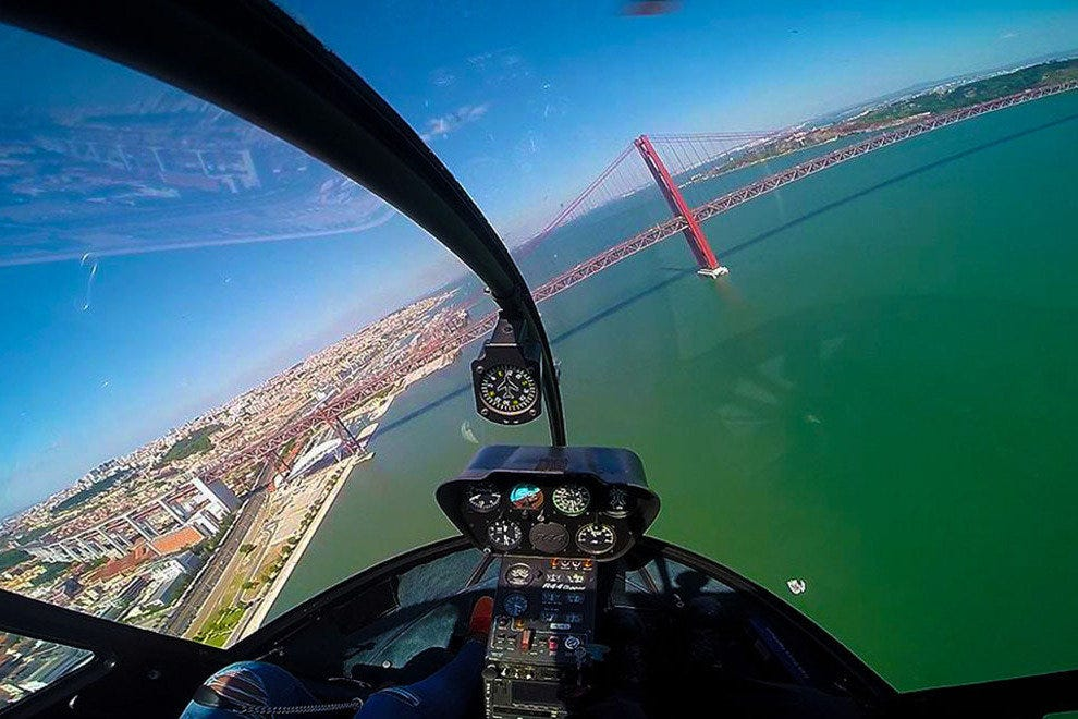 Flightseeing with Lisbon Helicopters takes in landmarks like the impressive Ponte 25 de Abril suspension bridge