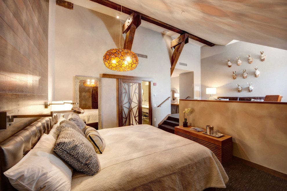 The Loft rooms recall a western lodge; wall art and carved bathroom doors create an inviting aesthetic