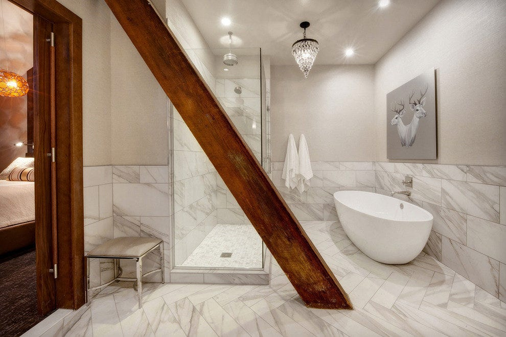 Loft rooms were built around exposed timber. Even the bathrooms feature artwork
