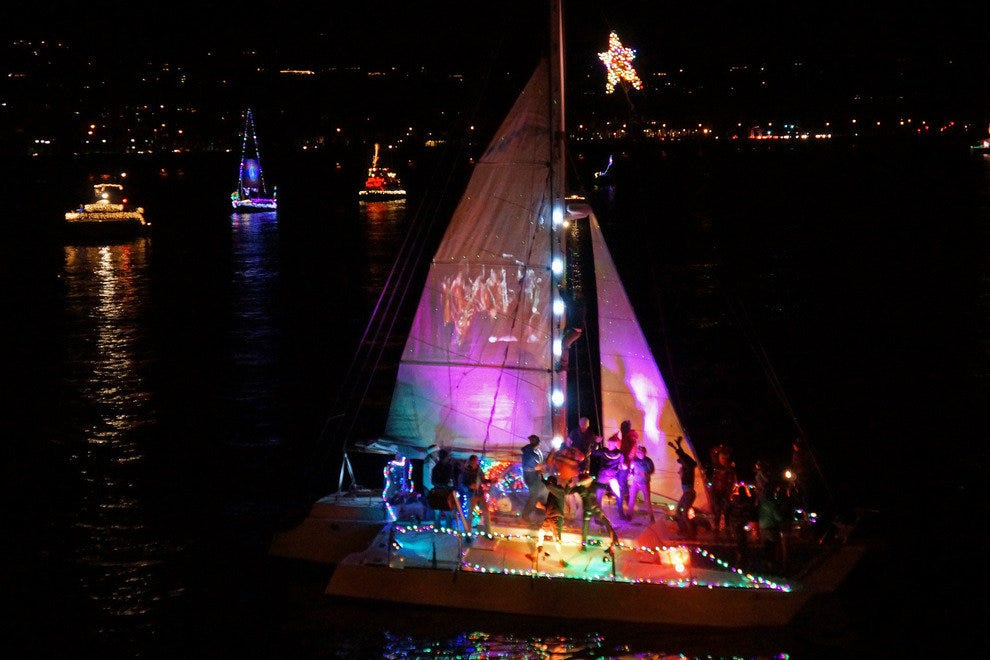 At the Parade of Lights in Santa Barbara, you can watch a fleet of boats with Christmas decorations pass you by