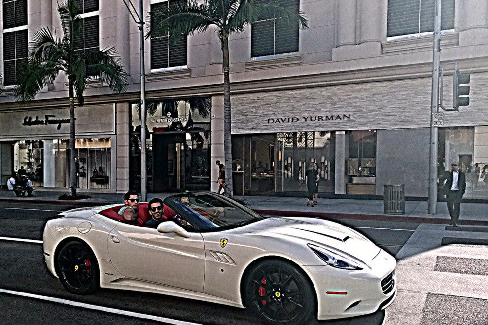 Cool cars on Rodeo Drive in front of David Yurman