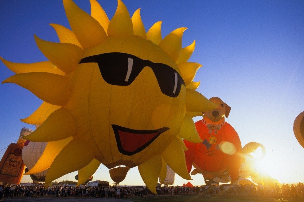 "A special shape balloon ""Sunny Boy"" inflates with its namesake. Special shape balloons (any non-traditionally shaped teardrop balloon) are so popular that they have their own flying days, called Special Shape Rodeos. Click here for a schedule of balloonin"