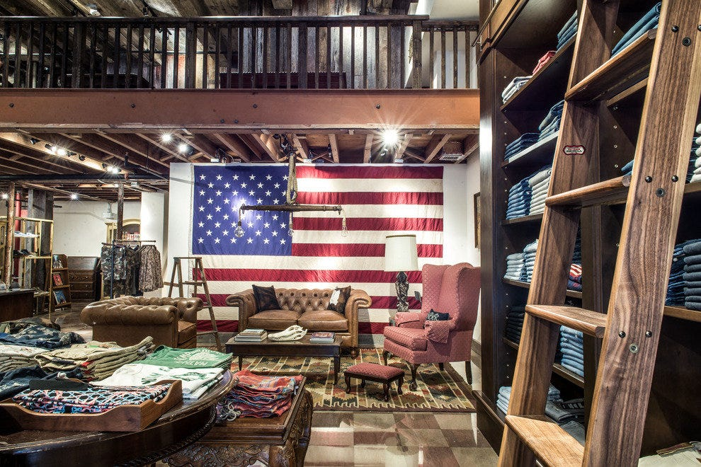 An American flag hangs over the store's cozy den