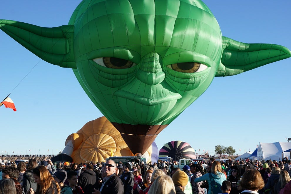For 2014's 43rd Fiesta, the Yoda special Shape balloon from Belgium inflated next to its Darth Vader counterpart to the surprise and delight of the estimated 100,000 person audience.