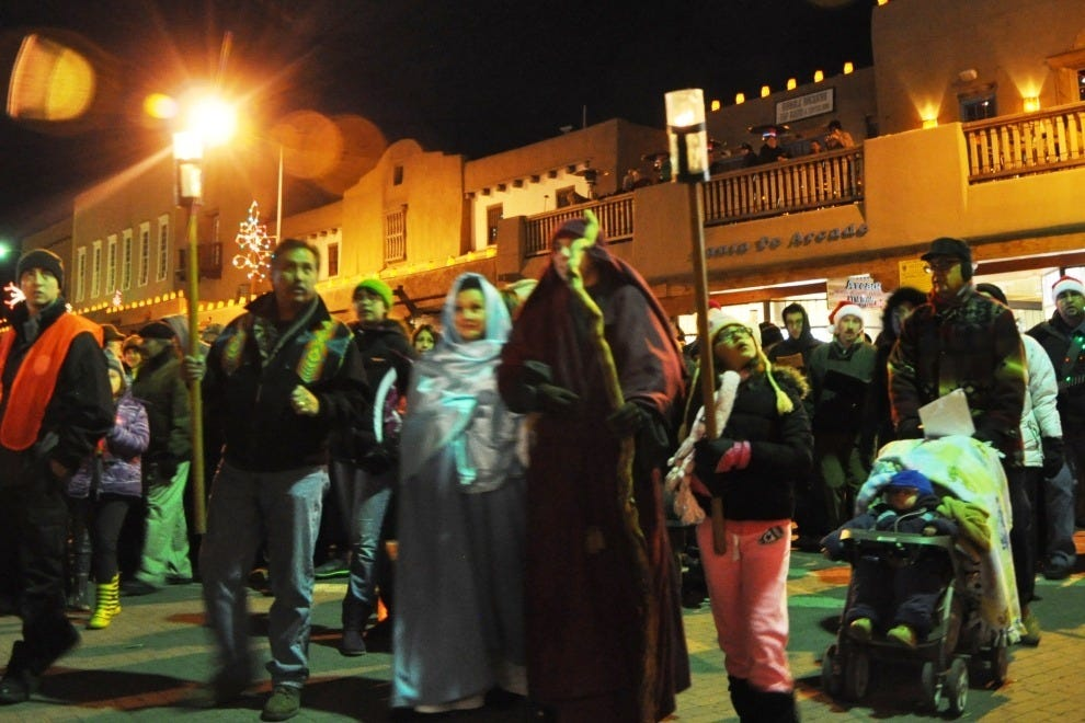 The Las Posadas procession, as it turns from San Francisco Street onto Lincoln Avenue