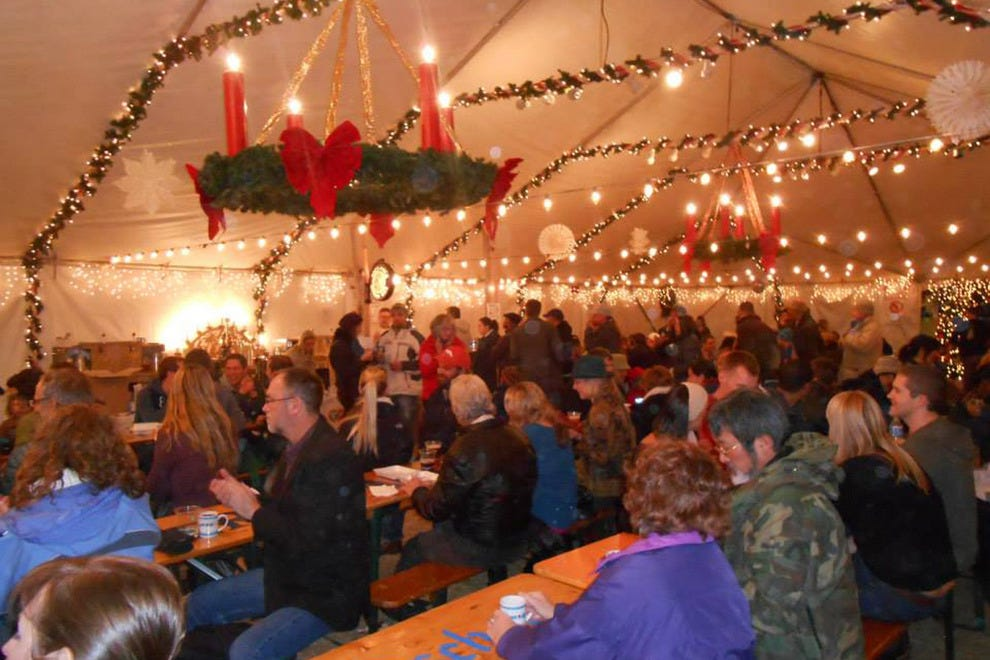 The heated America It's Time Holiday Tent is the perfect spot for holiday shoppers to relax and refuel with lunch and a beer