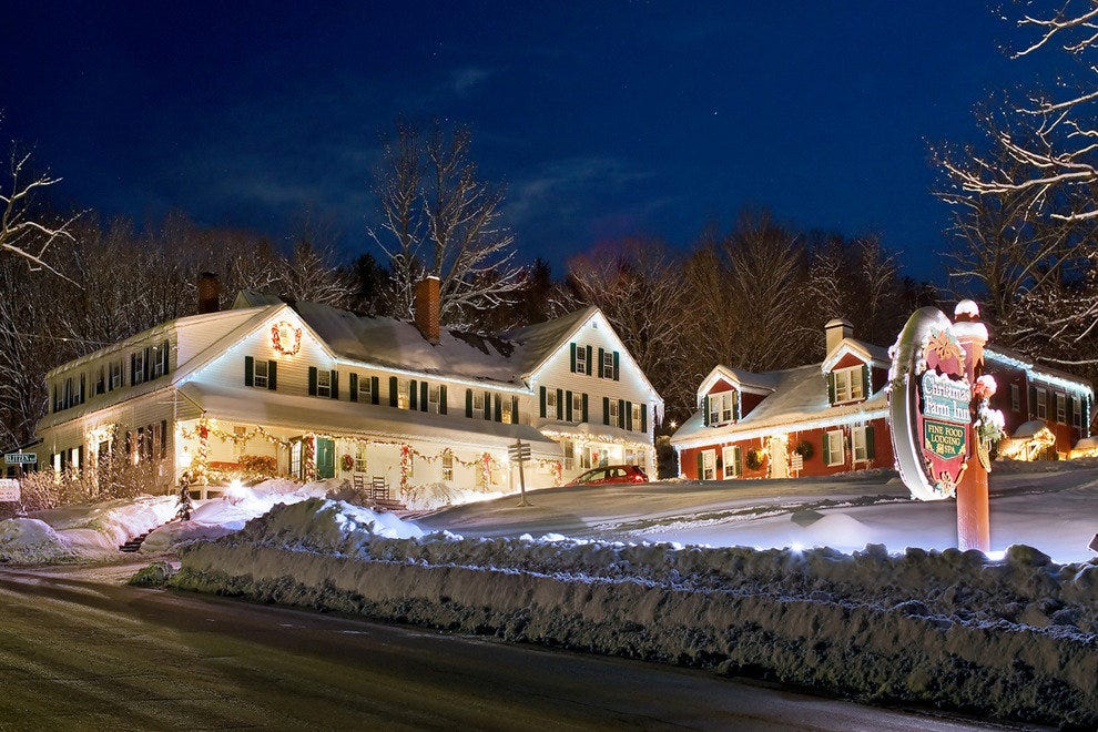 A blanket of snow and glowing lights is a welcoming site at the Christmas Farm Inn